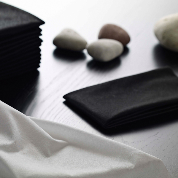 Black and white towels with pebbles